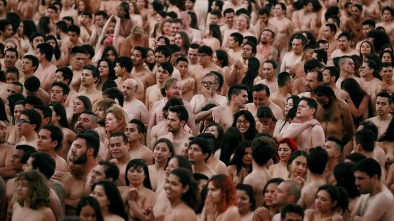 INSIGHT: Colombians strip for art