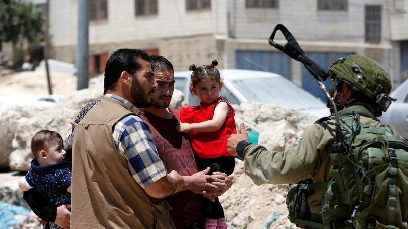Palestinian gunman's dad in shock
