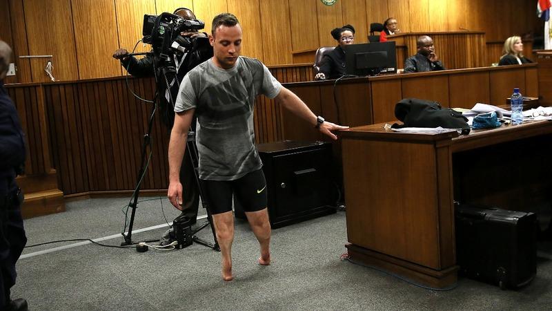 Pistorius strips false legs in defence gambit