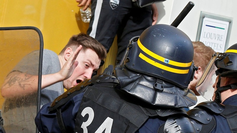 Riot police disperse England fans in Lille