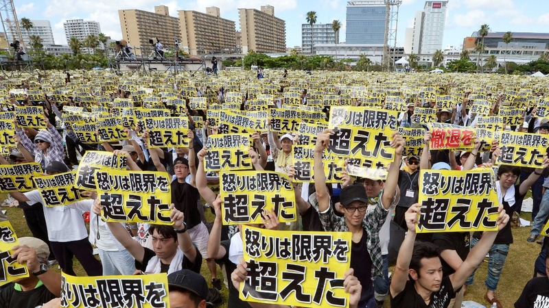 Protesters demand the US leave Japan
