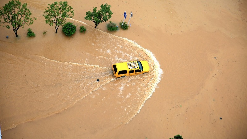 INSIGHT: At least 130 killed by floods in China