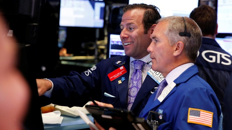 Stocks near record high on sharp hiring rebound