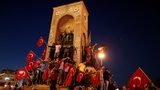 Erdogan supporters stand guard after coup bid