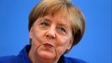 Merkel stands by refugee open-door policy