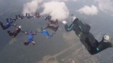 INSIGHT: Parachutists show off aerial acrobatic skills