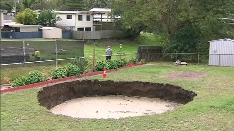 INSIGHT: Sinkhole swallows backyard in Australia