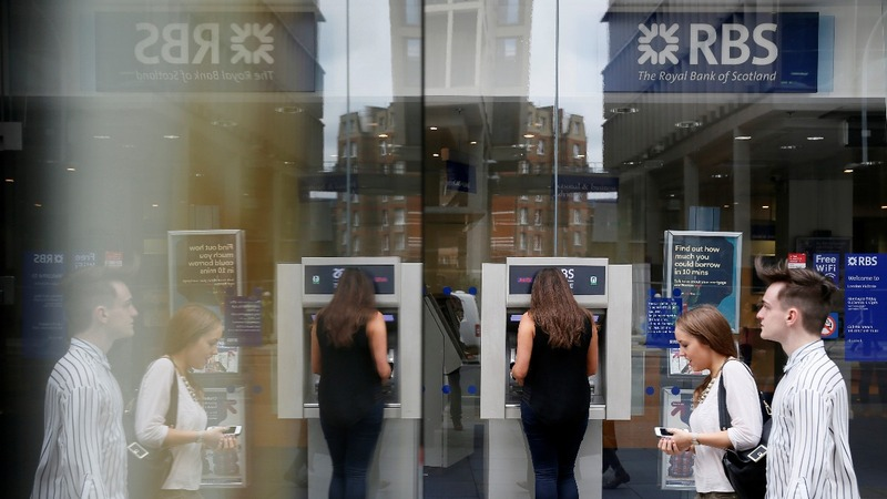 RBS posts £2 bln first-half loss
