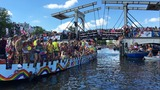 Revellers on boats for Amsterdam's EuroPride