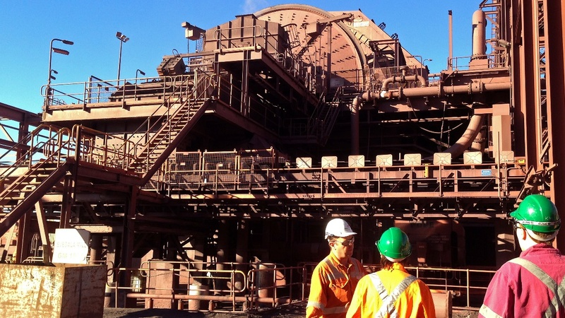 BHP Billiton books record loss