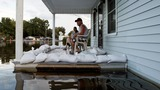 Deadly flood waters, federal aid and fear in Louisiana