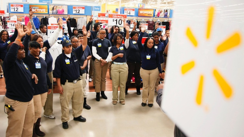 Wal-Mart shares up on higher forecast, rising wages
