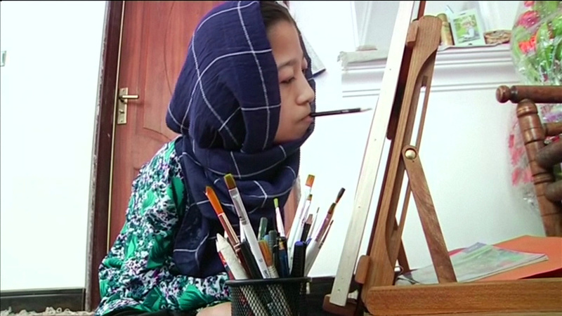 INSIGHT: Paralyzed Afghan sketches with her mouth