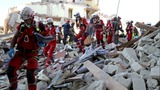 Italy quake toll at 247 as rescuers toil on