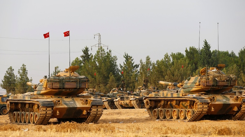 Turkey and Syrian rebels seize town from I.S.