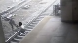 INSIGHT: Cop saves man from oncoming train