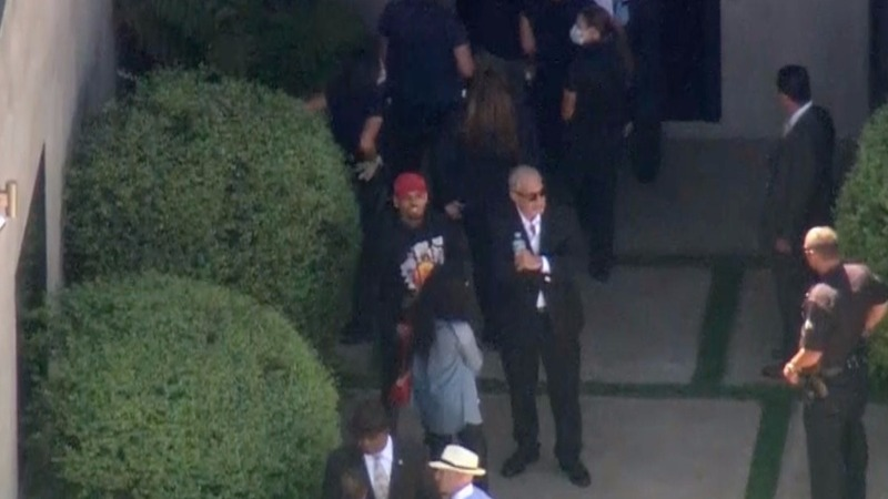 Chris Brown exits home after police standoff