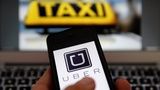 China probes Uber, Comcast dealmaking