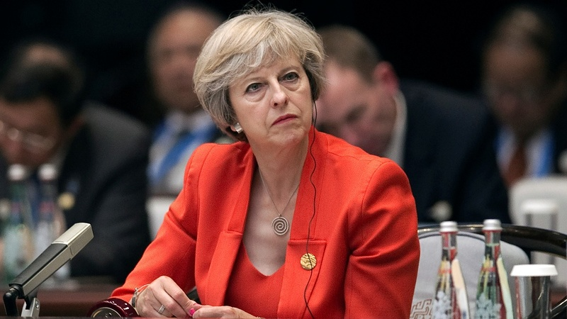 UK PM charts immigration collision course post Brexit