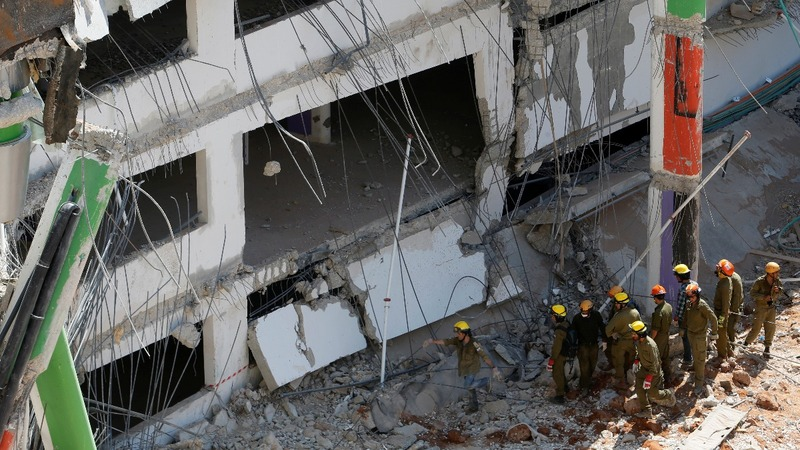 Two die in Tel Aviv parking lot collapse
