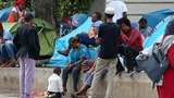 Paris to open first migrant camp in October