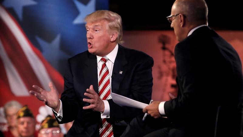 Clinton, Trump clash over intel briefing kiss & tell
