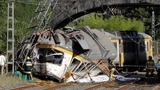 Crushed, derailed train kills 3 in Spain