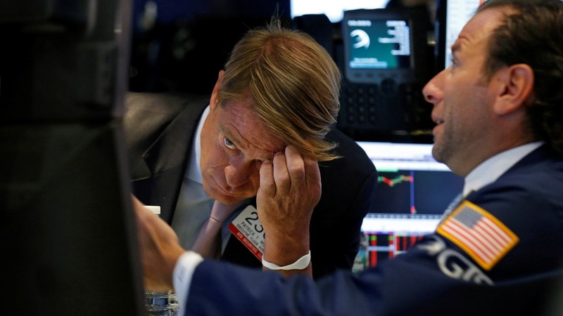 Dow plunges 400 points on Fed and nuke fears
