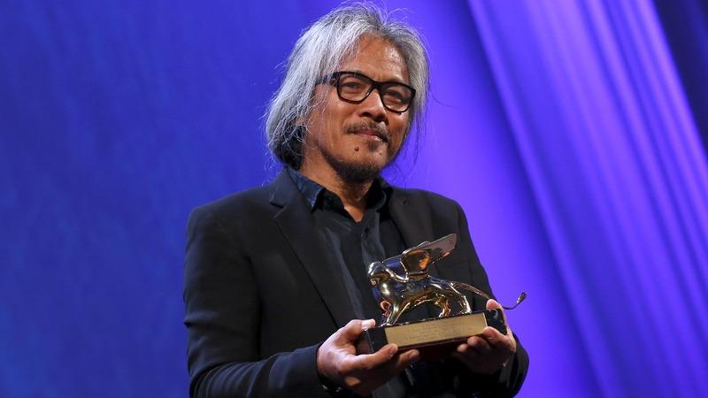 Four-hour long film wins top Venice prize