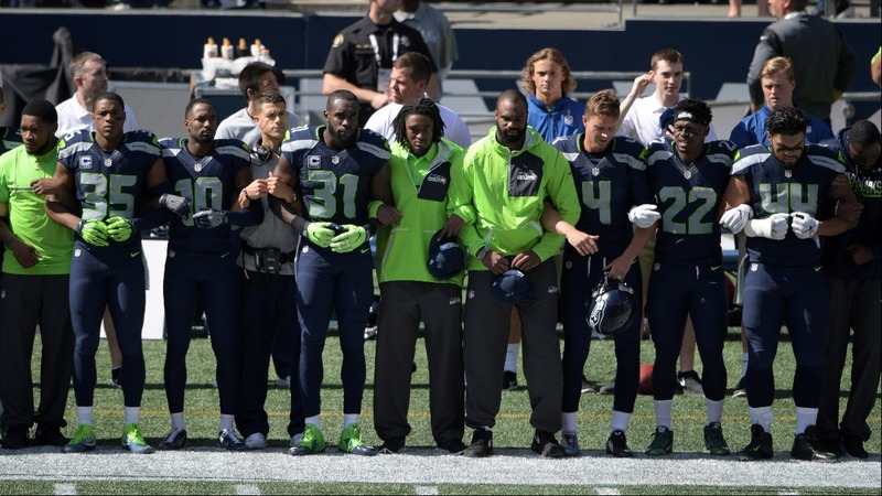 NFL players demonstrate in show of unity
