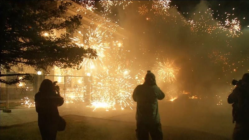 Protesters launch firecrackers at Russian embassy