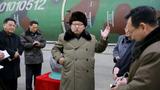 Kim Jong Un watches over rocket engine test
