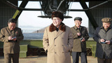 Kim Jong Un watches over rocket engine test