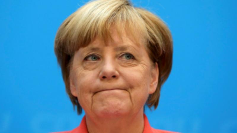 Merkel's 'mea culpa' shows shift in policy