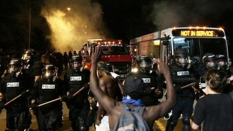 Streets of Charlotte ablaze after cops kill black man