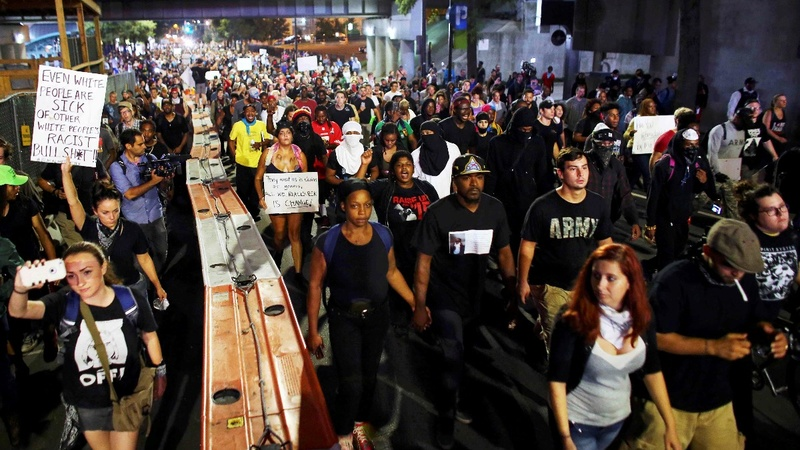 Charlotte protests break curfew, march on highway