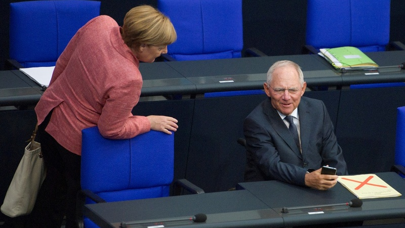 Schaeuble defends Bavarian ally over migrants