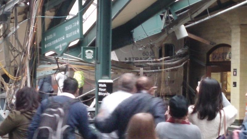 Train crashes through NJ train station