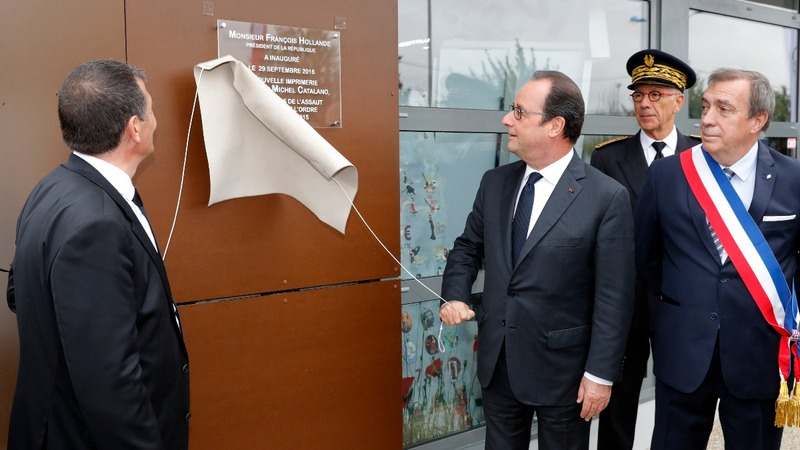Hollande re-opens site of Charlie Hebdo siege
