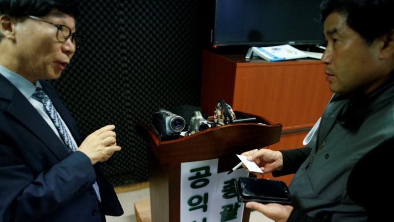 S. Korea pays paparazzi vigilantes to bust crime