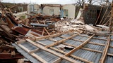 Houses 'folded over like cardboard boxes' in Haiti disaster