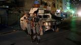 Gunman kills 14 in attack on Kabul shrine