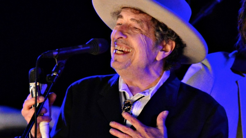 Dylan's poetic lyrics earn him surprise Nobel win