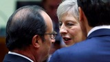 May tries to reassure EU over Brexit