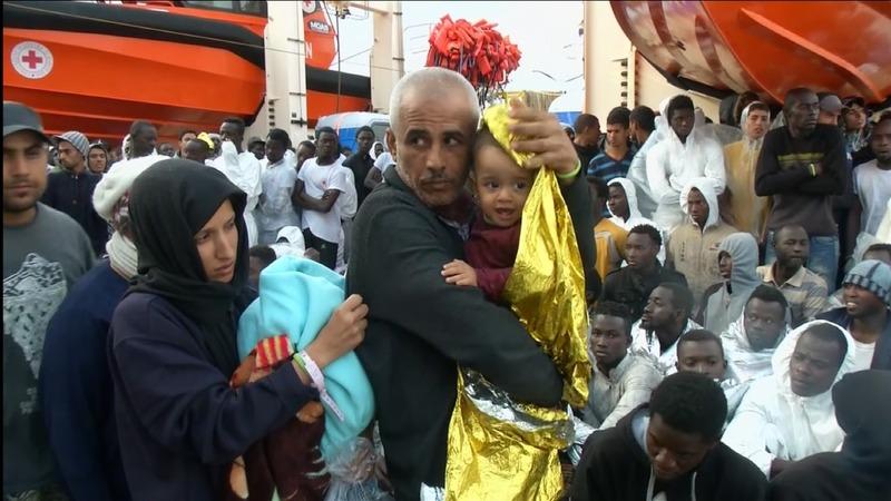 Migrants dock in Italy, face uncertain future