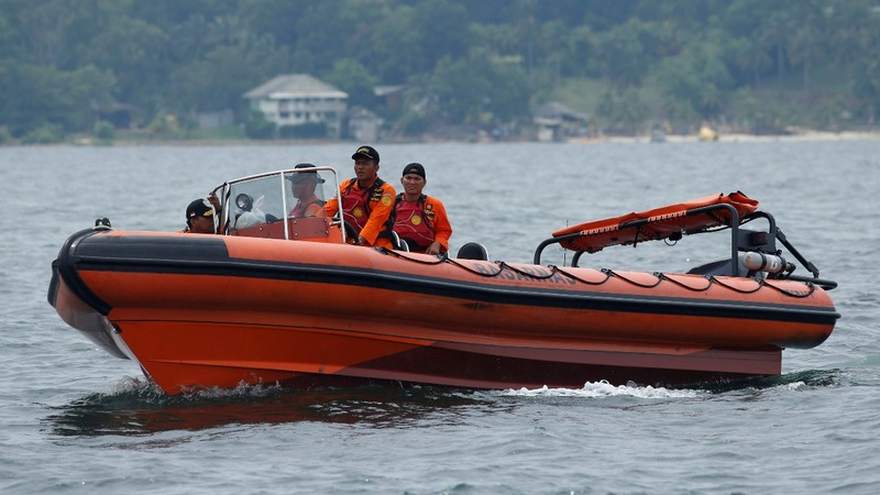 Indonesia scours waters for boat crash victims