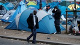 Thousands cleared from Paris migrant camp