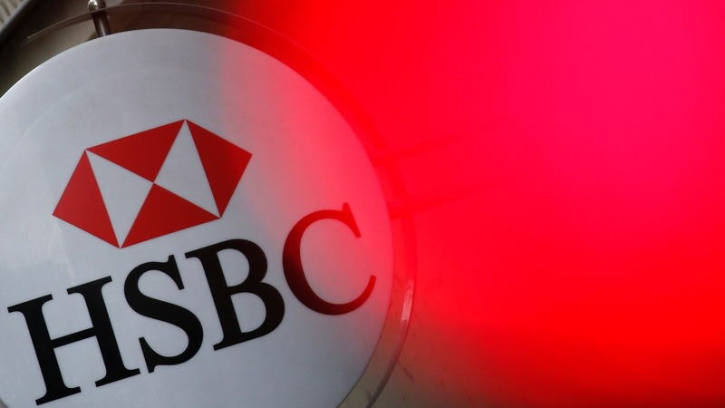 HSBC earnings slump on Brazil writedown