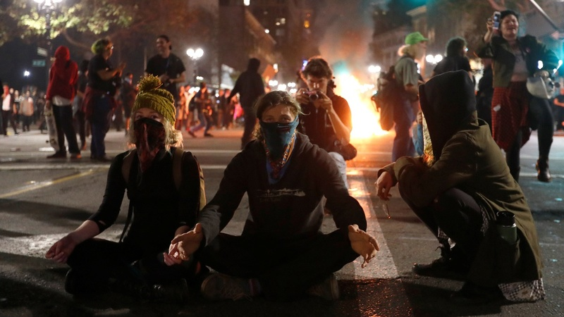 Rioting and arrests as anti-Trump rallies pack U.S. streets