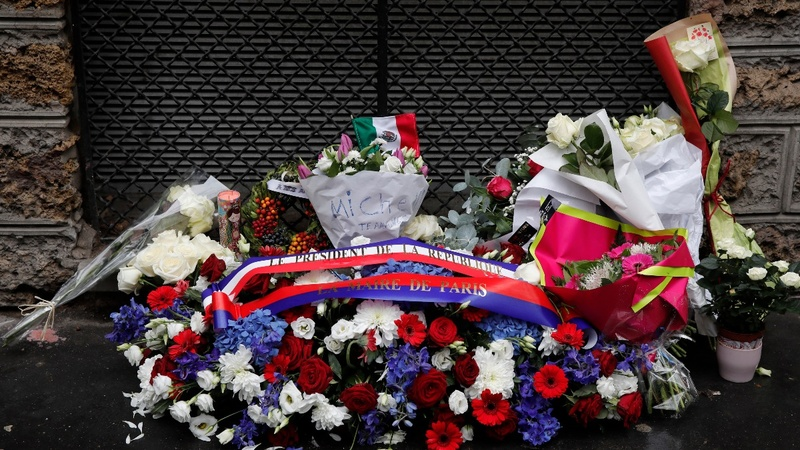 INSIGHT: Paris commemorates attacks one year on